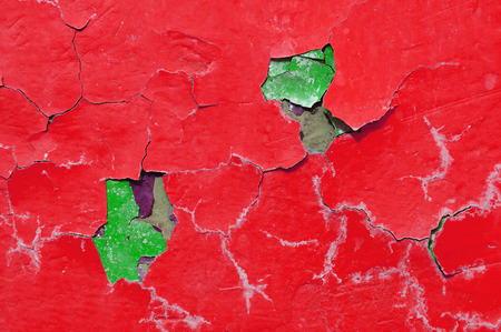 Texture background of red and green peeling paint on the old rough surface - texture background with chipped grunge paint on the texture wall Stock Photo