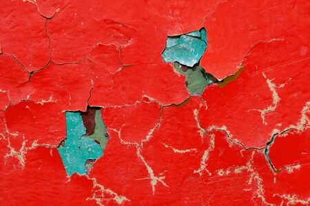 Texture background of red and green peeling paint on the old rough surface Stock Photo