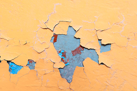deteriorate: Texture background of light yellow and blue peeling paint on the old rough surface