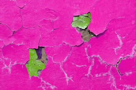 Texture background of pink peeling paint on the old rough surface Stock Photo