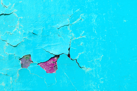 Texture background of turquoise peeling paint on the stone surface