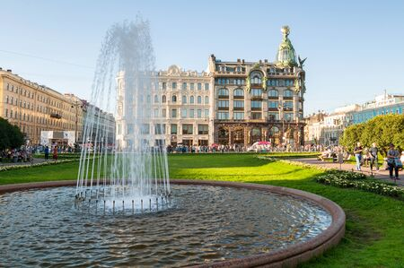 ST PETERSBURG, RUSSIA-AUGUST 15, 2017. Zinger House on Nevsky Prospect in the historic center of the city and fountain on the foreground. Summer evening in St Petersburg center, Russia Editorial