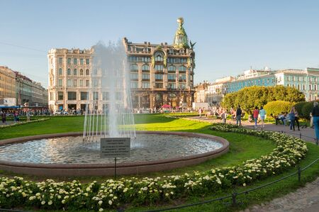 ST PETERSBURG, RUSSIA-AUGUST 15, 2017. Zinger House on Nevsky Prospect in the historic center of the city and fountain on the foreground. Summer evening in St Petersburg, Russia Editorial