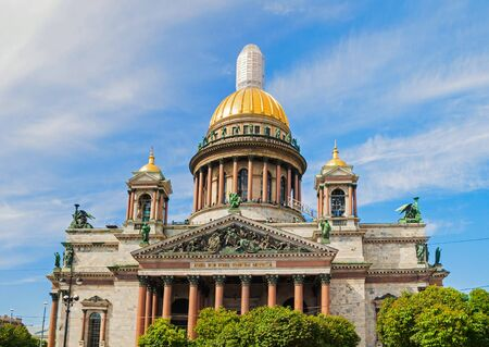 St Petersburg, Russia. Facade of St Isaac Cathedral. Architecture landscape of St Petersburg Russia landmark on the background of blue sky Stock Photo