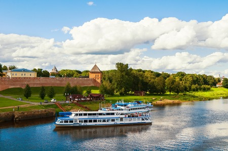 VELIKY NOVGOROD, RUSSIA - MAY 29, 2016. Veliky Novgorod Kremlin and touristic sailboats at the pier at the Volkhov river. Travel landscape of Veliky Novgorod, Russia