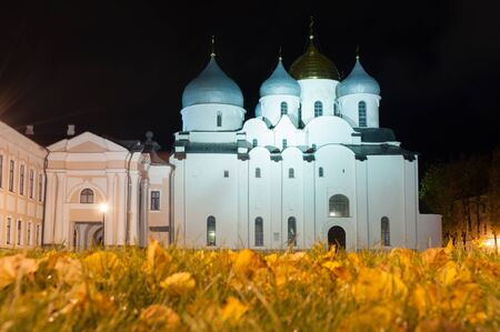 Night autumn view of Veliky Novgorod, Russia. Saint Sophia Cathedral in Veliky Novgorod, Russia in autumn night. Focus at the cathedral