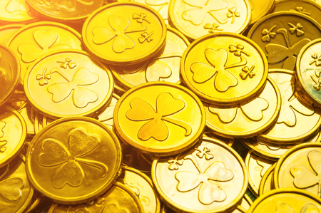 St Patrick's Day background. Golden coins with shamrock, St Patrick's day concept. St Patricks day festive background Фото со стока