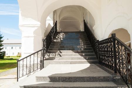 Staircase with antique wrought iron railing in Nicholas Vyazhischsky stauropegic monastery, Veliky Novgorod, Russia Stock Photo