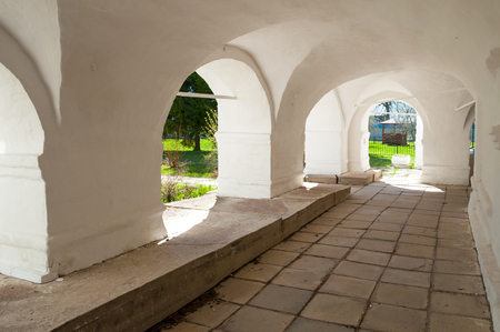 Veliky Novgorod, Russia. Archway of St Nicholas Vyazhischsky stauropegic monastery, architecture background 스톡 콘텐츠