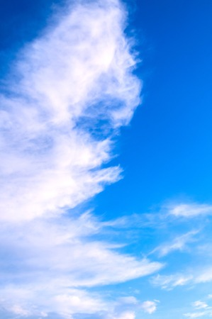 Blue cloudy sky background with dramatic colorful clouds, vast cloudy sky landscape