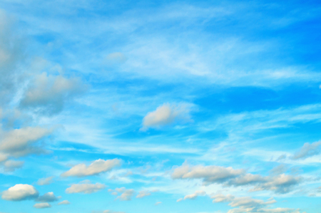 Blue cloudy sky background - blue dramatic colorful clouds, vast cloudy sky landscape