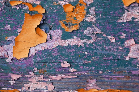 Texture background - wooden surface covered with old peeling paint