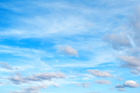 Blue cloudy sky background with blue dramatic colorful clouds, vast cloudy sky landscape