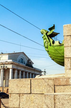 St Petersburg, Russia. Figurehead at the rostral column on the background of Old exchange building in St Petersburg Russia. Landmarks of the Vasilievsky island spit