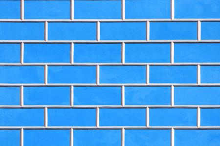 Brick wall background - new bricks wall pattern. Texture brick wall of bright blue color