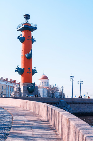 St Petersburg, Russia - April 5, 2019. Rostral column and custom building - landmarks of the Vasilievsky island spit in spring day. City landscape of St Petersburg, Russia