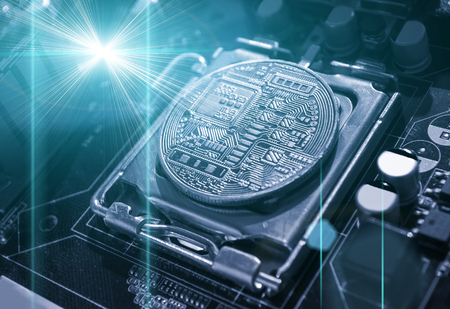 Bitcoin composition. Silver bitcoin among the electronic computer components, business concept of bitcoin digital cryptocurrency. Blockchain technology composition