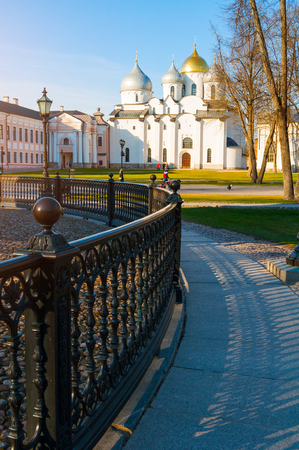 Veliky Novgorod, Russia - April 22, 2019. St. Sophia Cathedral at spring sunset with wrought iron fence of Millenium of Russia monument on the foregound in Veliky Novgorod, Russia