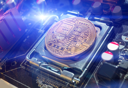 Bitcoin composition. Blockchain technology composition, bitcoin mining concept. Golden bitcoin among the electronic computer components