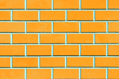 Brick wall background - new bricks wall pattern. Texture brick wall of orange color
