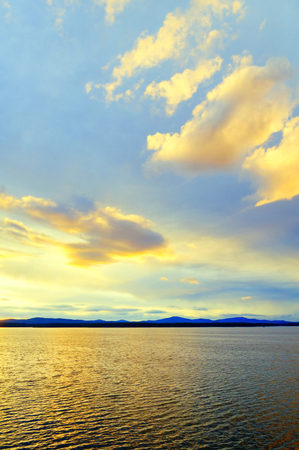 Sea sunset landscape. Sea water surface lit by soft sunset light. Summer sunny water scene in soft picturesque tones. Sea summer nature view Stock fotó