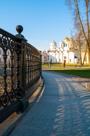 St. Sophia Cathedral at summer sunset with wrought iron fence of Millenium of Russia monument on the foregound in Veliky Novgorod, Russia. Travel landscape