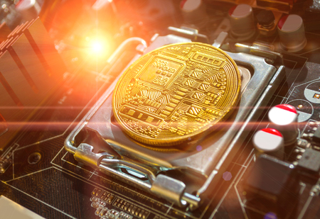 Bitcoin composition. Golden bitcoin among the electronic computer components, business concept of bitcoin digital cryptocurrency. Blockchain technology composition, bitcoin mining concept