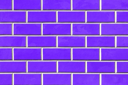 Brick wall background - new bricks wall pattern. Texture brick wall of purple color