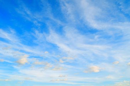 Blue dramatic sky background - colorful clouds, beautiful vast sunset sky landscape