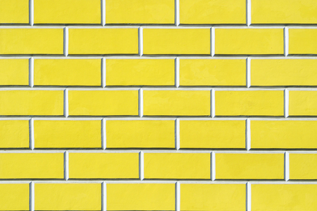 Brick wall background - new bricks wall pattern. Texture brick wall of yellow color Banco de Imagens