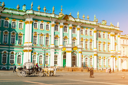 St Petersburg, Russia - April 5, 2019. State Hermitage Museum and poeple walking at the Palace Square. Winter palace and its precincts form the Hermitage Museum. City landscape of St Petersburg