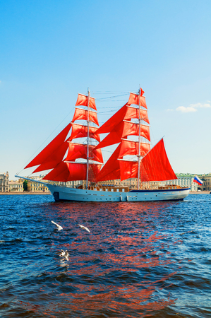 St Petersburg, Russia - June 6, 2019. Russian brig Russia with Scarlet sails on the Neva river. Scarlet Sails is the Russian holiday of school graduates, celebrated in St Petersburg every year