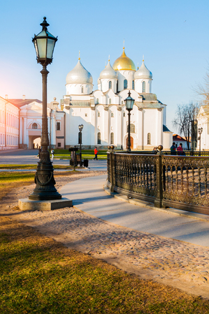 Veliky Novgorod, Russia - April 22, 2019. St. Sophia Cathedral at spring sunset and wrought iron fence of Millennium of Russia monument on the foregound in Veliky Novgorod, Russia