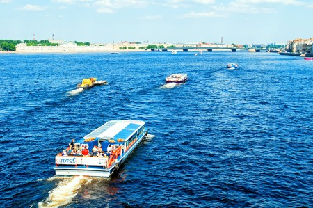 St Petersburg, Russia - June 6, 2019. Water area of the Neva river and floating touristic sailboats in St Petersburg, Russia. Travel landscape of St Petersburg Russia