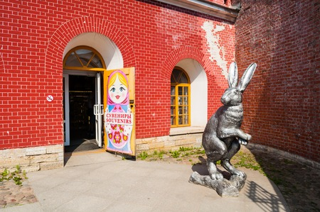 Saint Petersburg, Russia - June 6, 2019. Big rabbit sculpture and souvenir shop with Russian doll matrioshka at the entrance on the territory of Peter and Paul fortress in St Petersburg, Russia