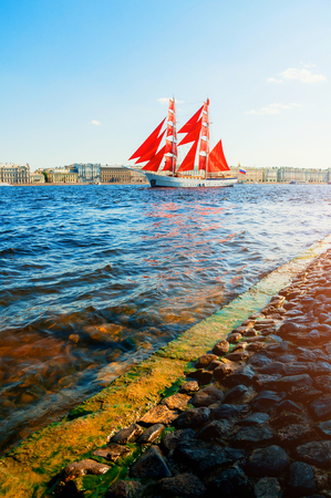 Saint Petersburg, Russia - June 6, 2019. Russian brig Russia with Scarlet sails on the Neva river. Scarlet Sails is the Russian holiday of school graduates, celebrated in St Petersburg every year
