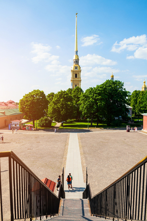 Saint Petersburg, Russia - June 6, 2019. Belfry of Peter and Paul cathedral - view from height. Territory of Peter and Paul Fortress in St Petersburg, Russia 스톡 콘텐츠 - 124999730