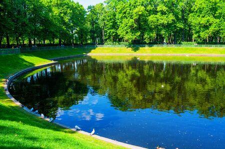 Summer landscape - Karpiev pond in Summer garden. Summer city landscape of St Petersburg, Russia 写真素材