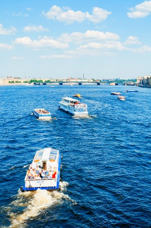 St Petersburg, Russia - June 6, 2019. Water area of the Neva river and floating touristic sailboats in St Petersburg, Russia. Travel river landscape
