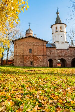 Veliky Novgorod, Russia. Church of the Annunciation at the Marketplace, connected to the church of the Archangel Michael by transition with a bell tower. Autumn sunny scene