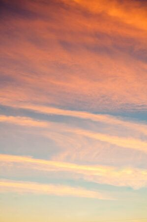 Blue dramatic sunset sky background - picturesque colorful clouds lit by sunlight. Vast sky landscape panoramic scene in soft pastel tones, sunset view 스톡 콘텐츠