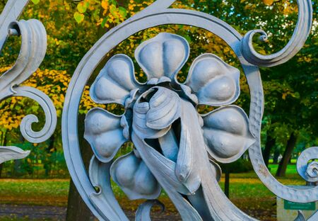 Autumn in St Petersburg - decorative detail in the form of flower at the fence of the Mikhailovsky Garden in St Petersburg, Russia in autumn day. Autumn architecture view of St Petersburg landmark