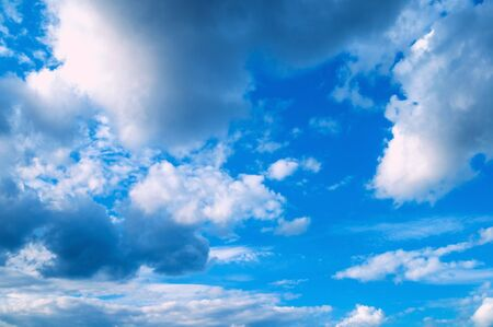 Blue dramatic sky background - picturesque colorful clouds lit by sunlight. Vast sky landscape panoramic scene, colorful sky view