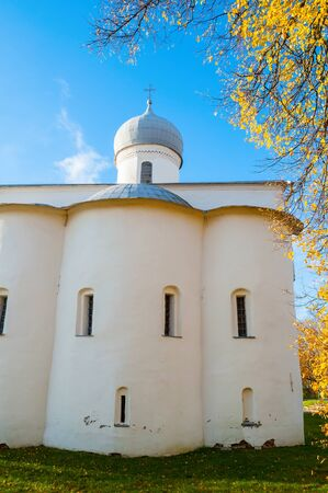 Veliky Novgorod, Russia. Assumption Church in sunny autumn morning at the Yaroslav Courtyard in Veliky Novgorod, Russia Stock fotó - 129690580