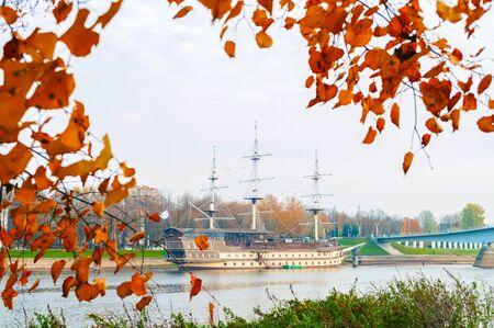 Veliky Novgorod, Russia - October 18, 2018. Frigate Flagship restaurant complex and water area of Volkhov river in Veliky Novgorod, Russia. Autumn cloudy city landscape Stock fotó