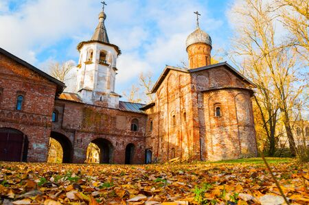 Veliky Novgorod, Russia. Church of the Annunciation at the Marketplace and bell tower in Veliky Novgorod, Russia. Autumn sunny view Stock fotó