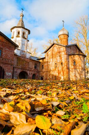 Veliky Novgorod, Russia. Church of the Annunciation at the Marketplace and bell tower in Veliky Novgorod, Russia. Autumn sunny scene Stock fotó