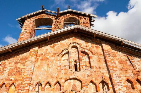 Veliky Novgorod, Russia. Church of St John the Merciful at Myachino in Veliky Novgorod, Russia - facade view. Focus at the church