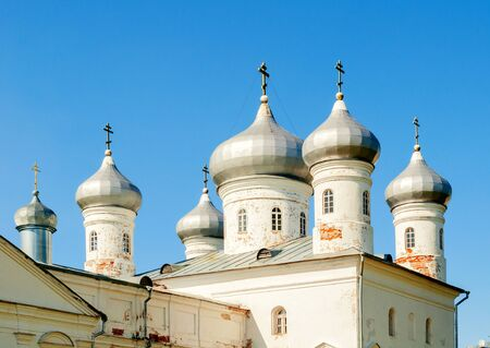 Veliky Novgorod, Russia. Saviour Cathedral on the territory of Russian orthodox Yuriev Monastery in spring sunny day, Closeup of domes and belfry