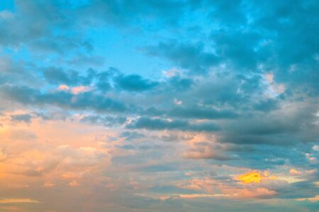 Dramatic sky background - picturesque colorful clouds lit by sunlight. Vast sky landscape panoramic scene, colorful sky view
